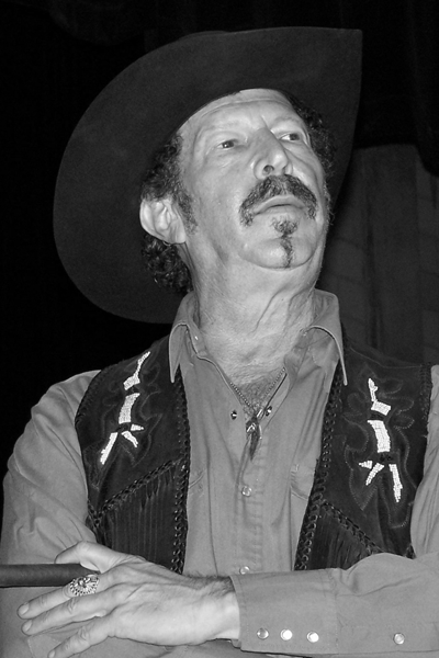 Picture of Kinky Friedman. © 2006 Larry D. Moore. Kinky Friedman contemplates a question from the audience at a campaign rally at the Bastrop High School, West Campus Gymnasium at 30.1181° -97.3159°, Bastrop, Texas, United States. 2006-OCT-11 7:30 p.m. Photograph created by Larry D. Moore (Nv8200p on en.wikipedia) using a Kodak EasyShare Z740 camera.