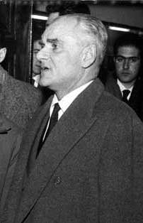 Picture of Alberto Moravia. If this image meets the definition of a simple photograph and was created prior to 1976, then it was out-of-copyright in Italy on the date of restoration (January 1, 1996) and is currently in the public domain in the United States.